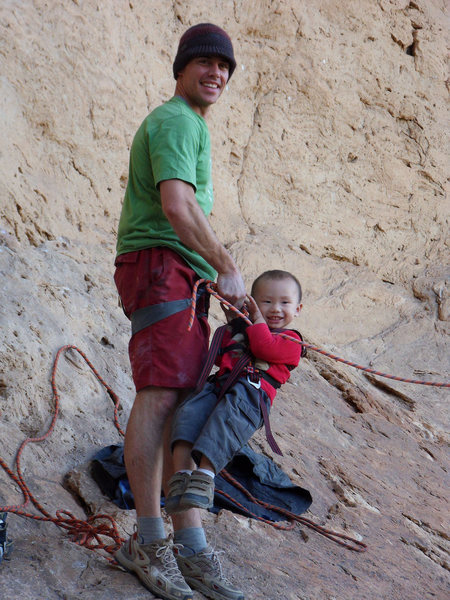 "Getting Dylan ready to take the king swing from the top of the slab out of the Big Horn Wall cave. It is about 40-50 feet and people in the parking lot think it is great, ""look at that guy up there swinging around"", if they only knew he was 3."