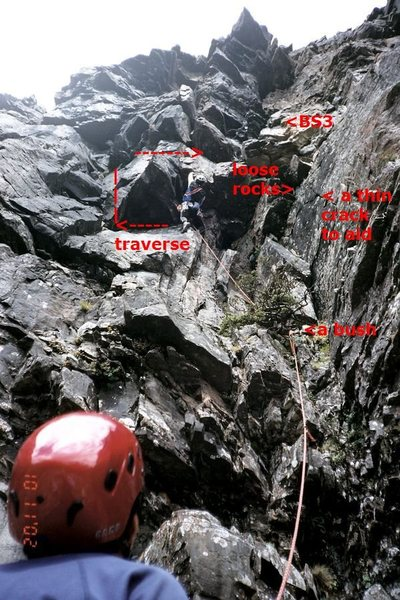 Our fearless leader, Raymond Chen, cranking up a big overhanging boulder up the pitch 2 (left alternative), where very loose rocks on his right, and he later decided to escape by traversing left, up, and right.