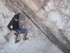Rock Climbing Photo: Lluis cleans the cam as he follows ZZZZ