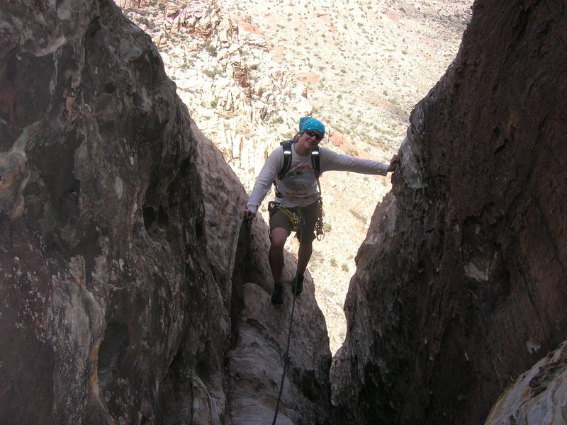 climbing into the alcove at the top of P5