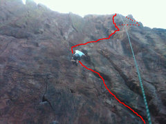 Cell phone photo of Mickey making his way to the ledge. I drew the route out (badly), as well as the variation we ended up taking after not being able to finish off the crux.