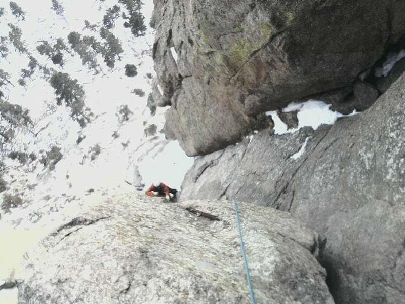 partner seconding pitch 4 in mid-january. The mass of snow below him is the last belay ledge.