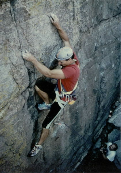 1989...JB on Three Piece Route (5.12-) at Windy Point overlook. Photo: Brian Kristofitz, Attentive belayer: Pete Lofquist.  (FA by EFR)