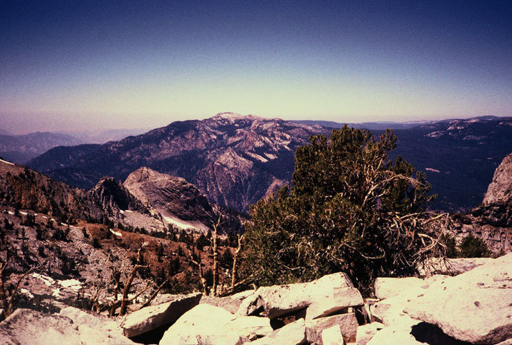 Descending north from Harrington Pass the Silver Turret comes into view. Spanish Mountain and The Obelisk are in the distance, across the Middle Fork.<br> <br> Photo by Guy Keesee, 1992.