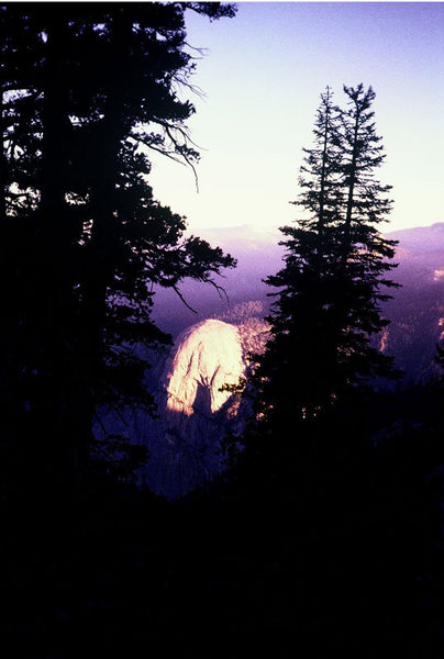 Tehipite Dome at sunrise, seen from camp under The Silver Turret.<br> <br> Photo by Guy Keesee, 1992.