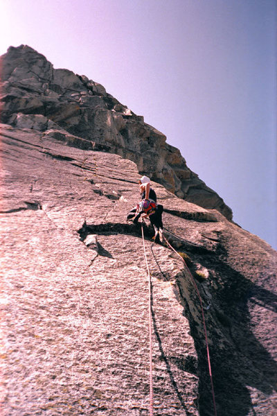 Kristian Solem leading on the North Buttress of The Silver Turret. We got stormed off later in the day.<br> <br> Photo by Guy Keesee, 1992.