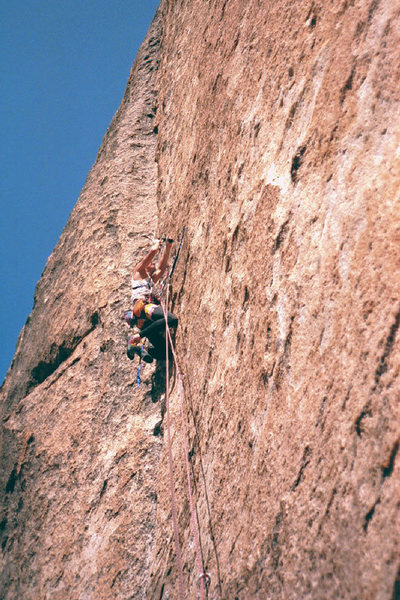 Kris Solem drilling on a hook. FA of From Afar.<br> <br> Photo by Guy Keesee, 1992.