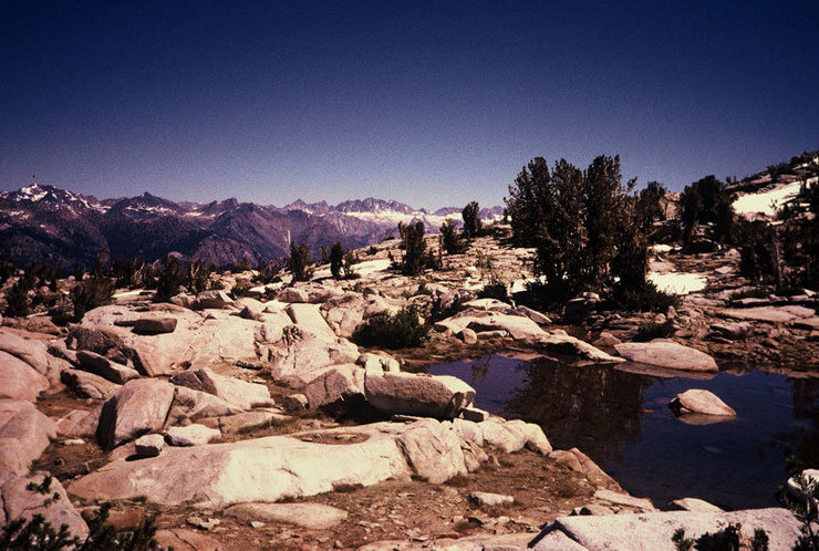 Harrington Pass features several small tarns. Mt. Agassiz, Winchell, and the Palisades crest are seen in the distance.