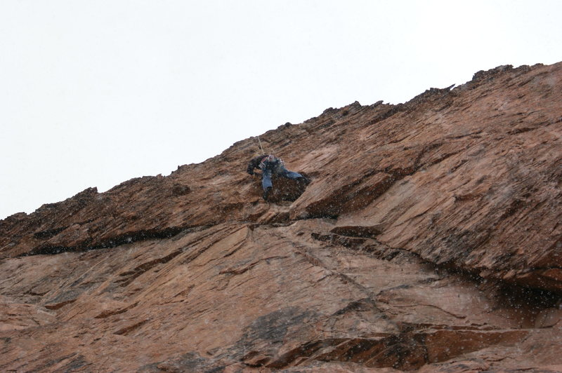 Steve at the crux in a snow storm on Footloose!