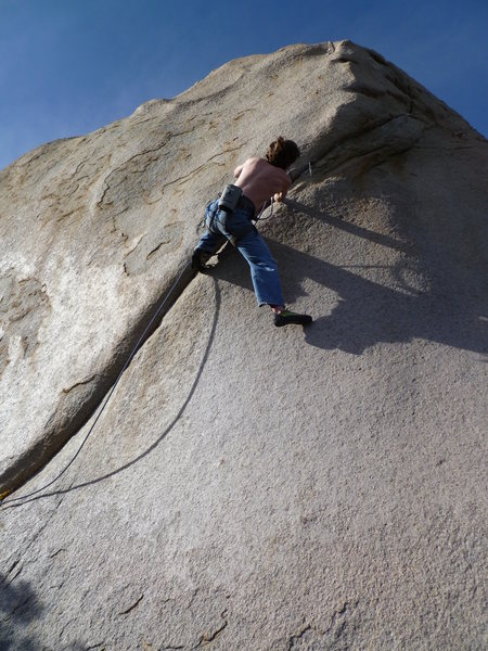 Doug placing a couple tiny cams before the crux