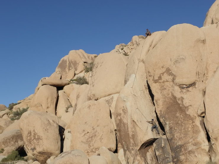 Cody following Tall Boy, Justin belaying from the top<br> (photo by Todd Gordon)