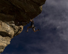 Rock Climbing Photo: Ben Lindfors sticking the final jug on Mighty Dog.