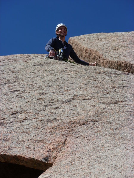 On top of the flake after the crux lieback.