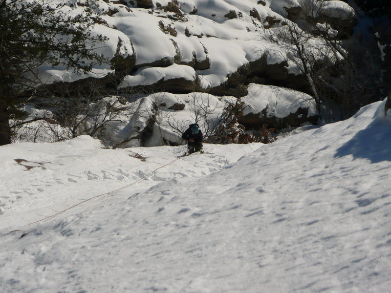 Kimberely following 1st pitch.  This was a 60m rope stretcher with no pro.  Thin but adequate ice on lower section and consolidated snow on upper part of pitch.