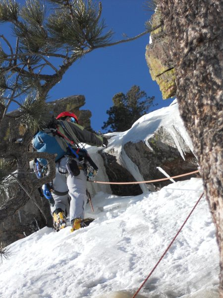 Working up ledges 3rd pitch, delaminated ice.