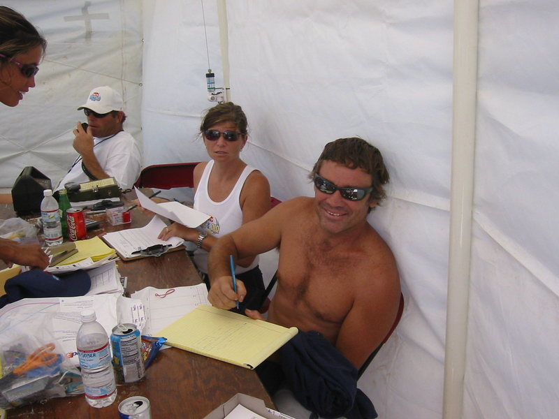 """Mike Waltze, Barri and John Denny, and Nori at the committee desk at the """"Red Bull King Of The Air"""" pro kiteboard event"""