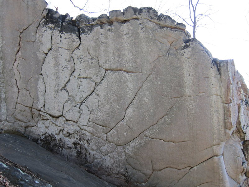 """The """"Graham Crackers"""" boulder.  """"Twin Cracks"""" climbs between the left most two cracks in the photo."""