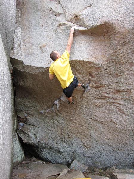 Rock Climbing Photo: Pulling over the lip on Instinct.