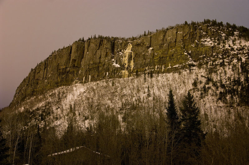 Northwest face of Mt. McRae lit by lights of Thunder Bay. Big ice falls in the middle are Childs Play and Chucky's Revenge.
