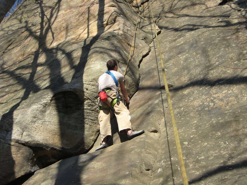 roger eyeballing the crux on the layback.