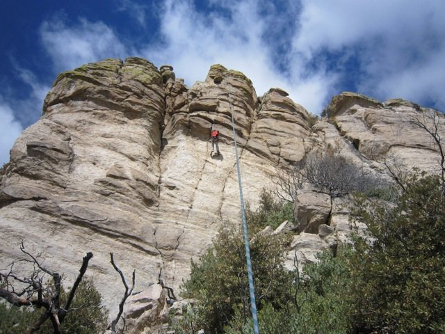 Grain Dance stays in the crack system to the right of climber.