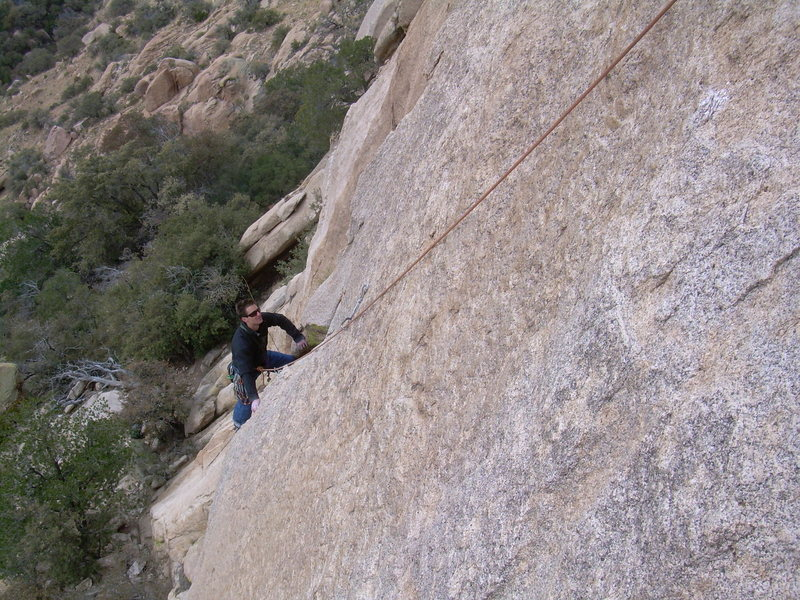 Rock Climbing Photo: Wyatt sizes up the final slab crux on the 1st pitc...