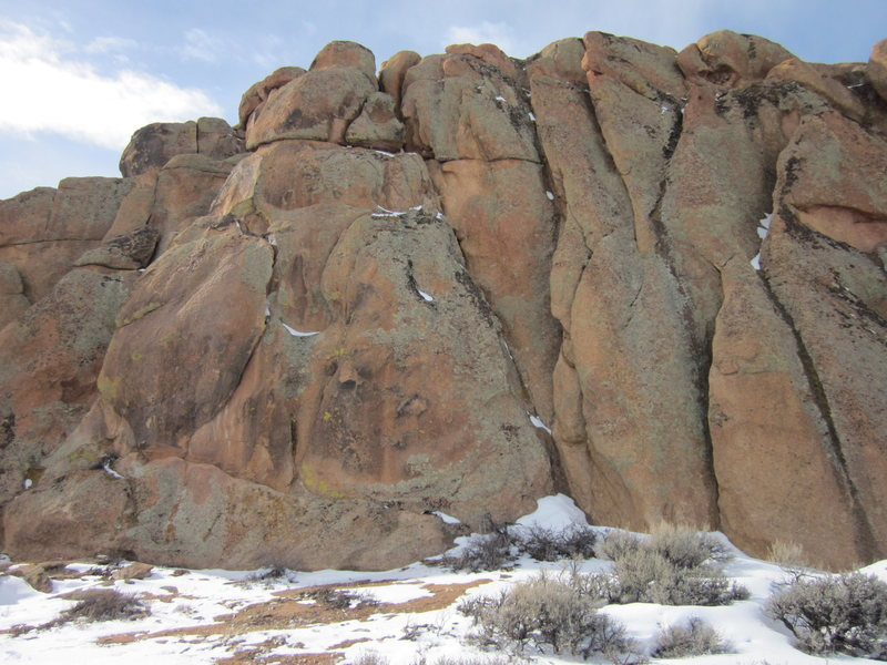 Crack, Baby! climbs the left-leaning crack that runs from the top to bottom of the Beginner's Backside. The line that is basically in the middle of this photograph.