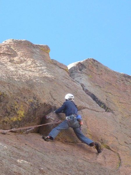 Just below the crux.  Footholds on the face make the setup for the pull over the roof a little easier.