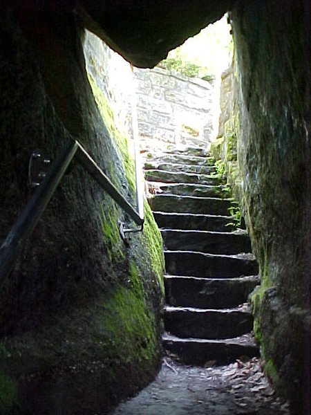 The upper section of the staircase that leads through the rocks to the base.