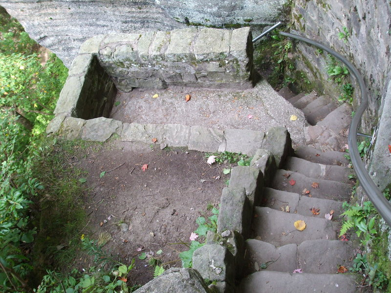 The small overlook near the bottom of the staircase that leads through the rocks to the base.