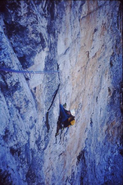 Susan Wolfe climbing the crux 5.12a/5.10 A1 pitch 3