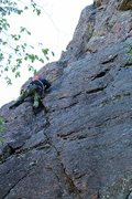 Me heading up One Pine at Farm Rock, Gatineau Park. Unfortunately this area is now closed to climbing. <br /> <br />