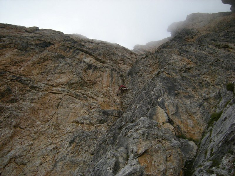 Leading the polished misery that is pitch 2 of Trenker route on First Sella Tower (drizzlyl August day in 2008).