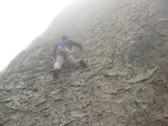 Rock Climbing Photo: Heading up in the oncoming fog and rain