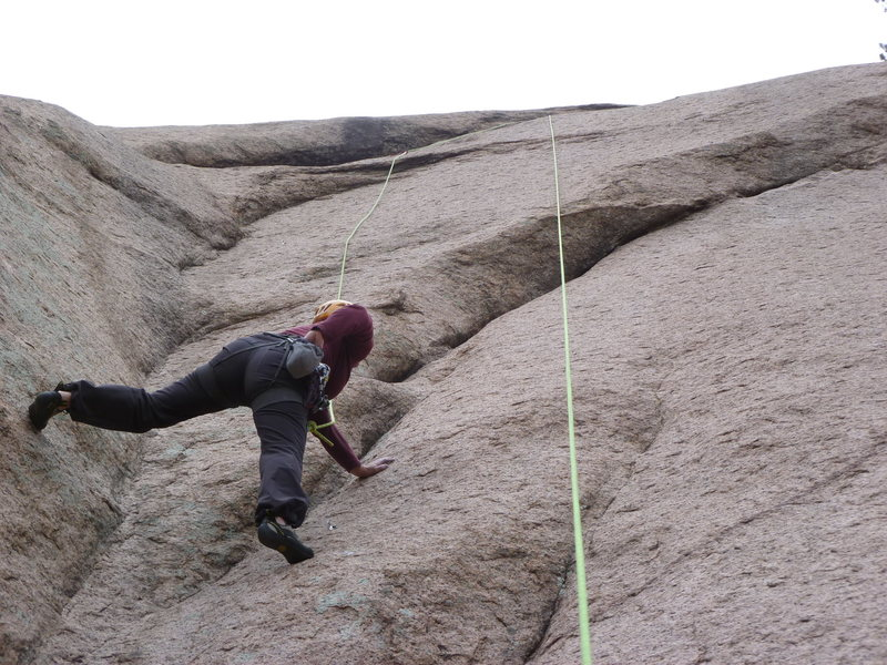 Rock Climbing Photo: Moving above the first bolt.  The rock is very wat...