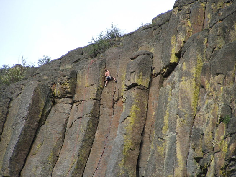 Climber on Orange Sunshine 5.10b