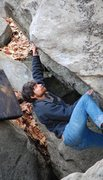 Rock Climbing Photo: Sam setting up for the moves at the lip.