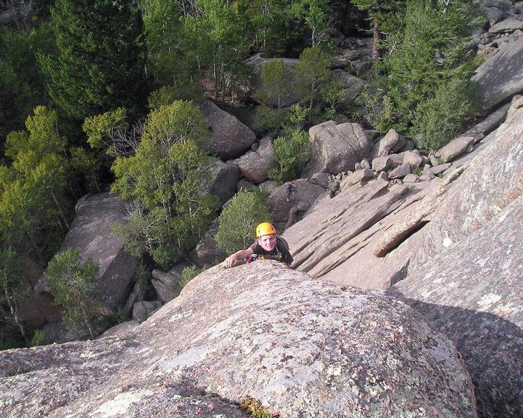 Alex climbing the first pitch.