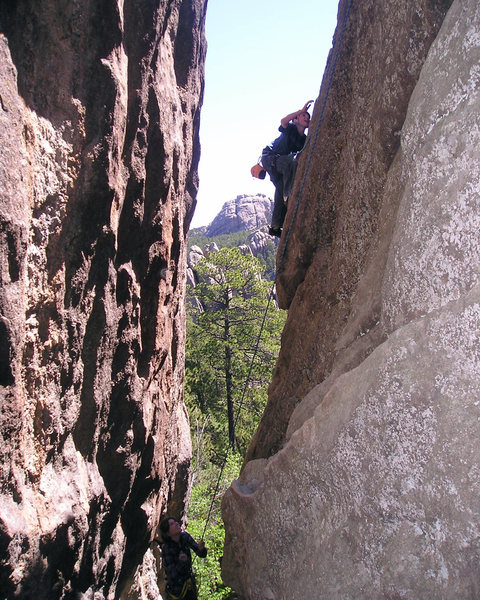 Alex climbing with Baldy in the background