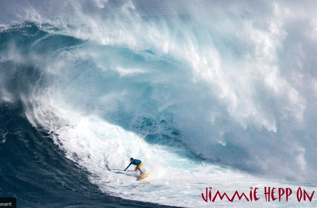 Kai Lenny paddling in at Jaws on his SUP