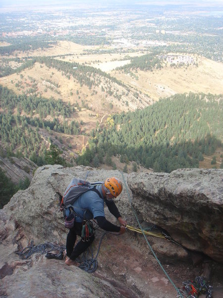 Dave at anchor 3, high above Boulder, East Face Right, Seal Rock.
