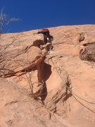 Rock Climbing Photo: Sadie stepping out of the dihedral.  Photo by Mich...