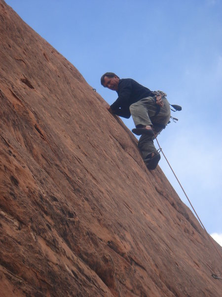 Working the thin smears high on the route.