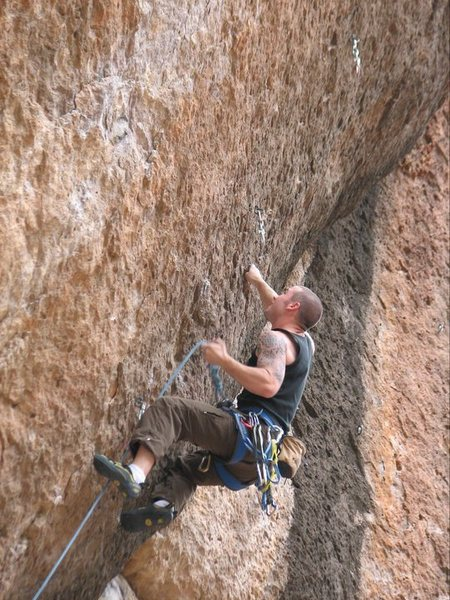 Rock Climbing Photo: Clipping the fourth bolt on the route.