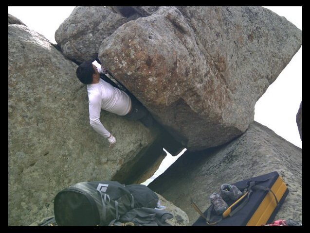 "Direct Variation to ""Jaws of Life"" instead of finishing out on the face, continue out the offwidth crack. Just take the direct line out of the cave. Tricky offwidth moves."