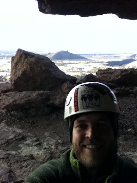 Relaxing in the West Cave, after deciding to continue even though it was snowing as I left the last belay.