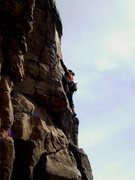 Rock Climbing Photo: Lauren glides upwards in the March sunshine.