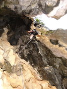Rock Climbing Photo: Jean Redle climbing out of the tube to finish up t...