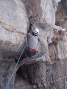 Rock Climbing Photo: Elias leading thru the first roof crux.  The Grott...