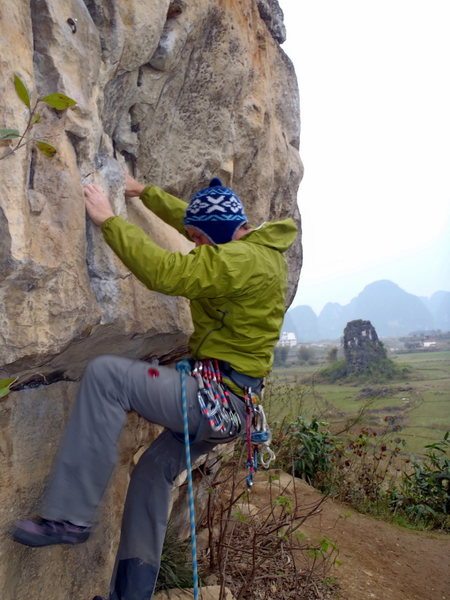 The boulder start on Rooster Booster on a cold drizzly day.  The Egg Yangshou China.